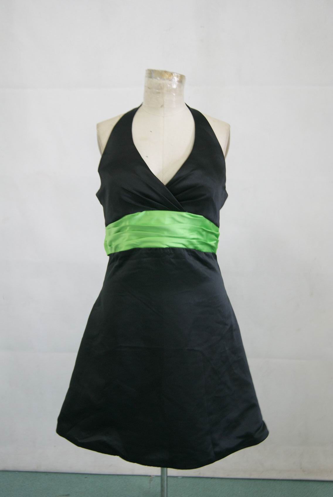 black dress with lime green sash