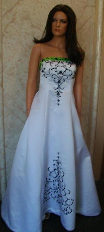 white dress with green trim and black embroidery