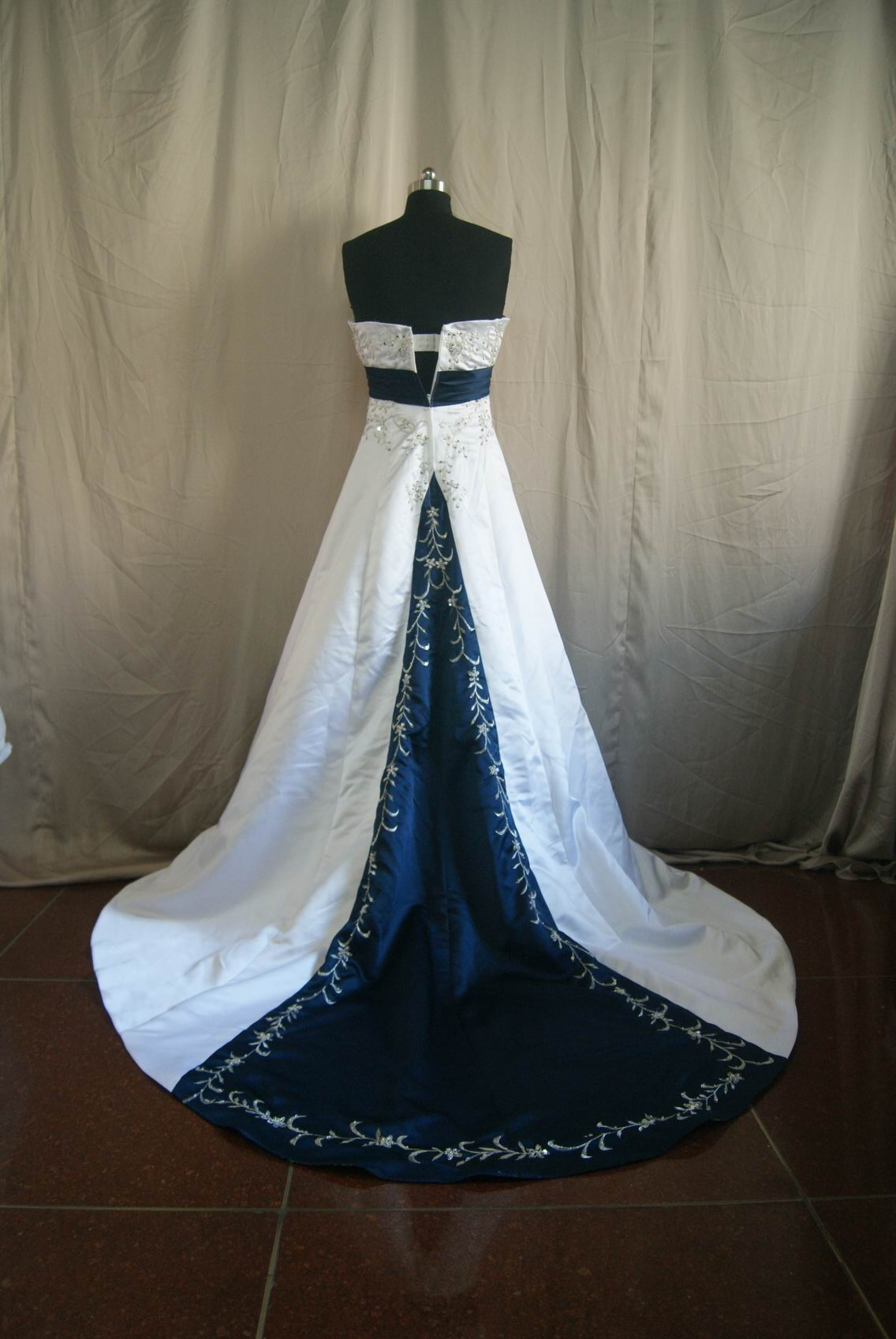white and navy wedding gown