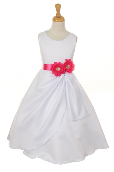 white dress with fuchsia flower sash