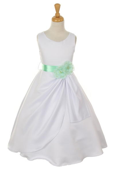 white dress with mint flower sash