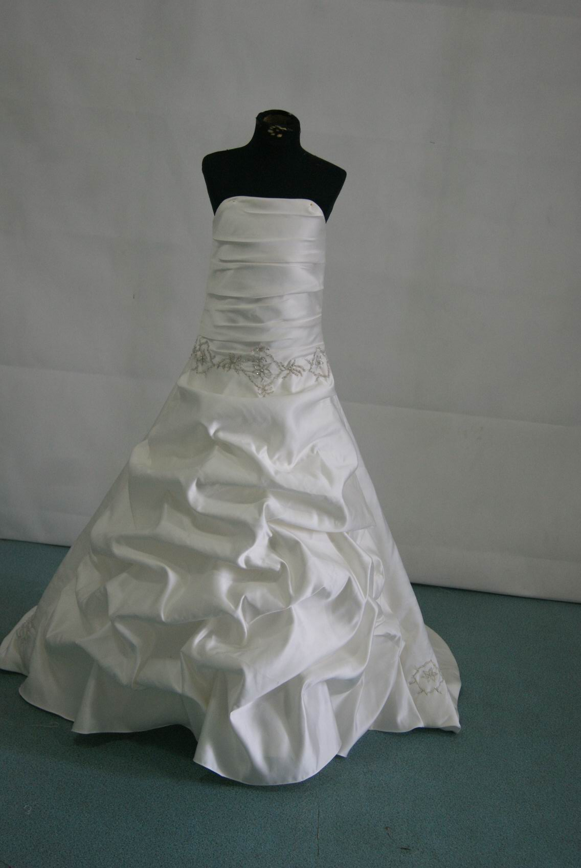 White miniature bridal gown with silver embroidery