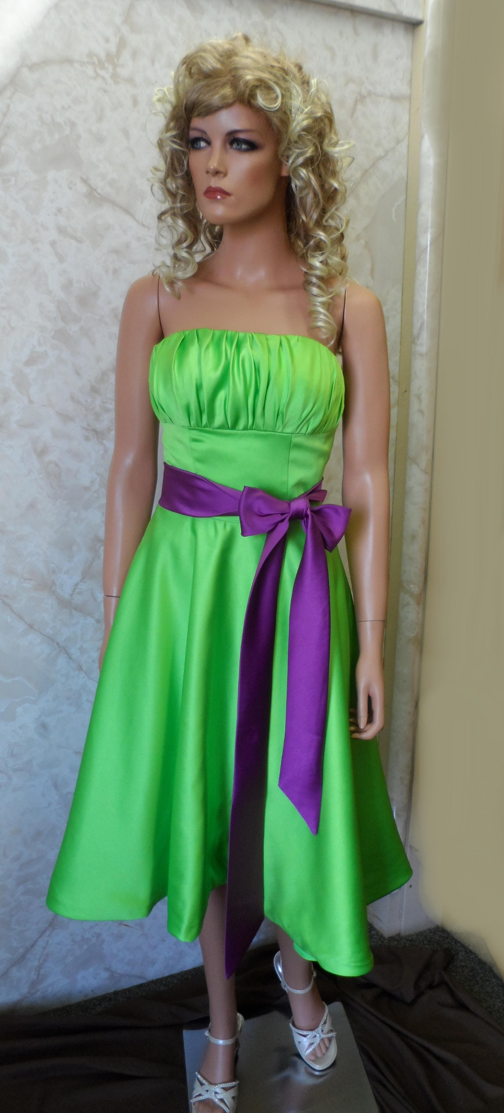 short green bridesmaid dress with purple sash