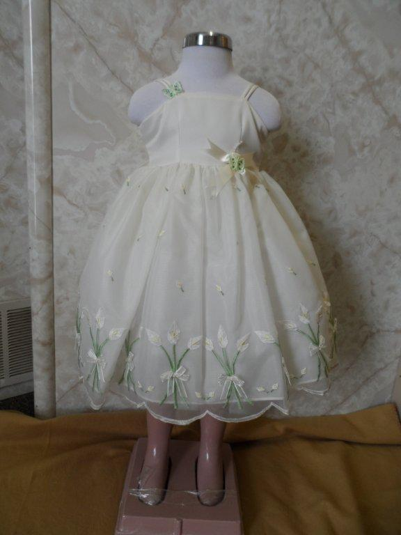 ivory dress with green stems and yellow flowers