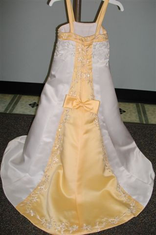 Yellow Bow Accents The Back Of This Train Dress