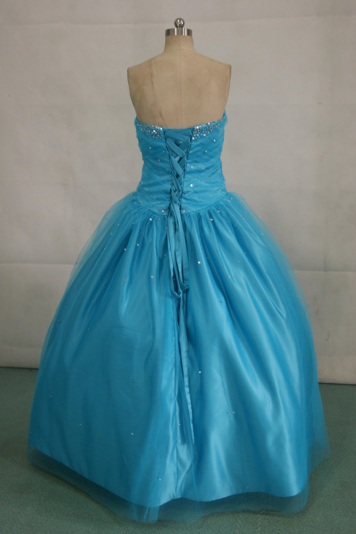 Peacock blue prom dress with silver beading