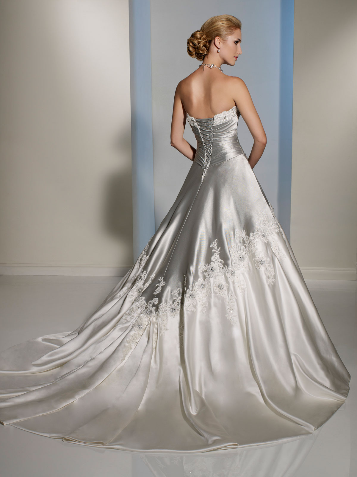 Silver and white draped bodice wedding dress.