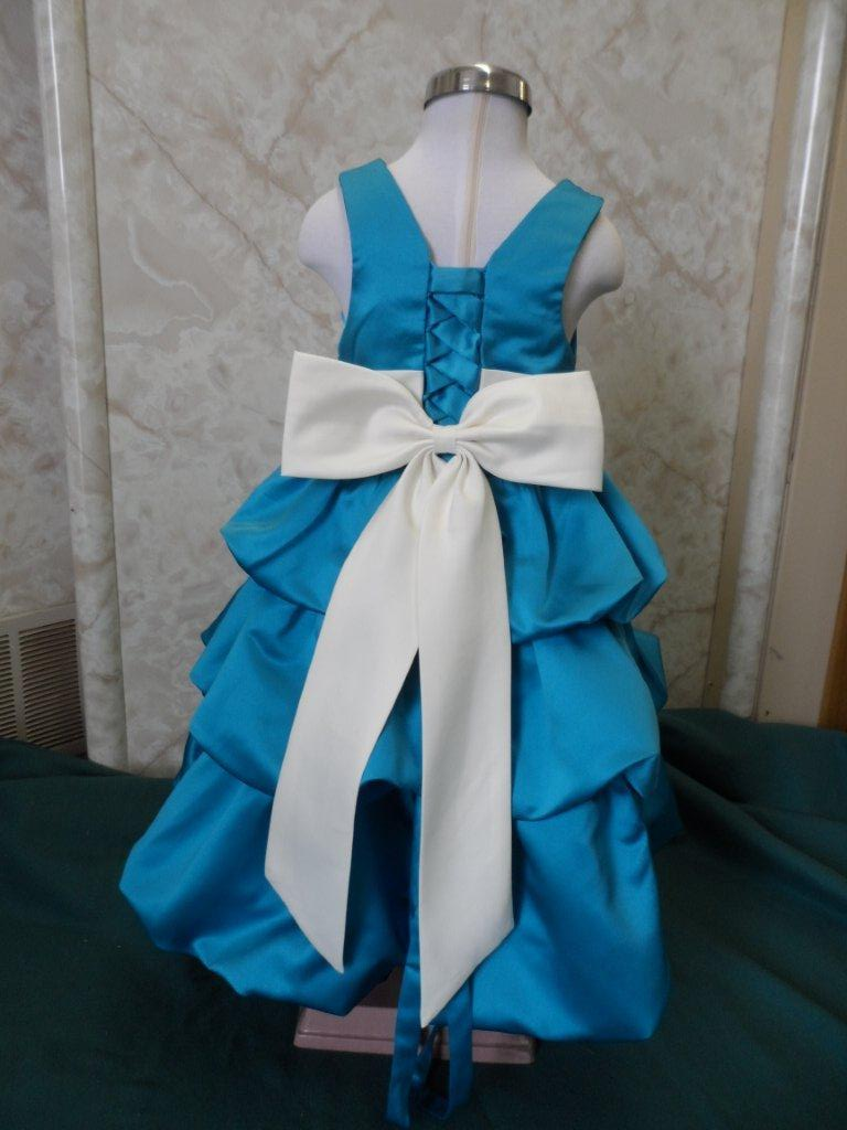 Our daughters turquoise flower dress is simply beautiful