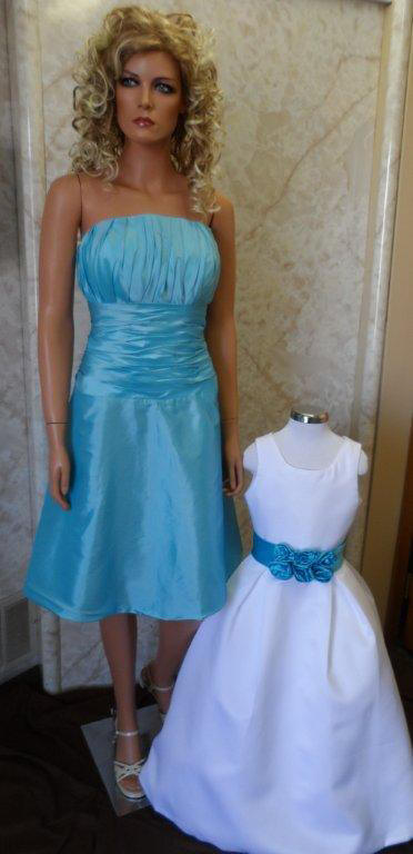 short pool blue bridesmaid dress and matching flower girl sash