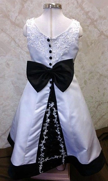 c63c2258271 Girls black and white dress - Button Bow Dress.