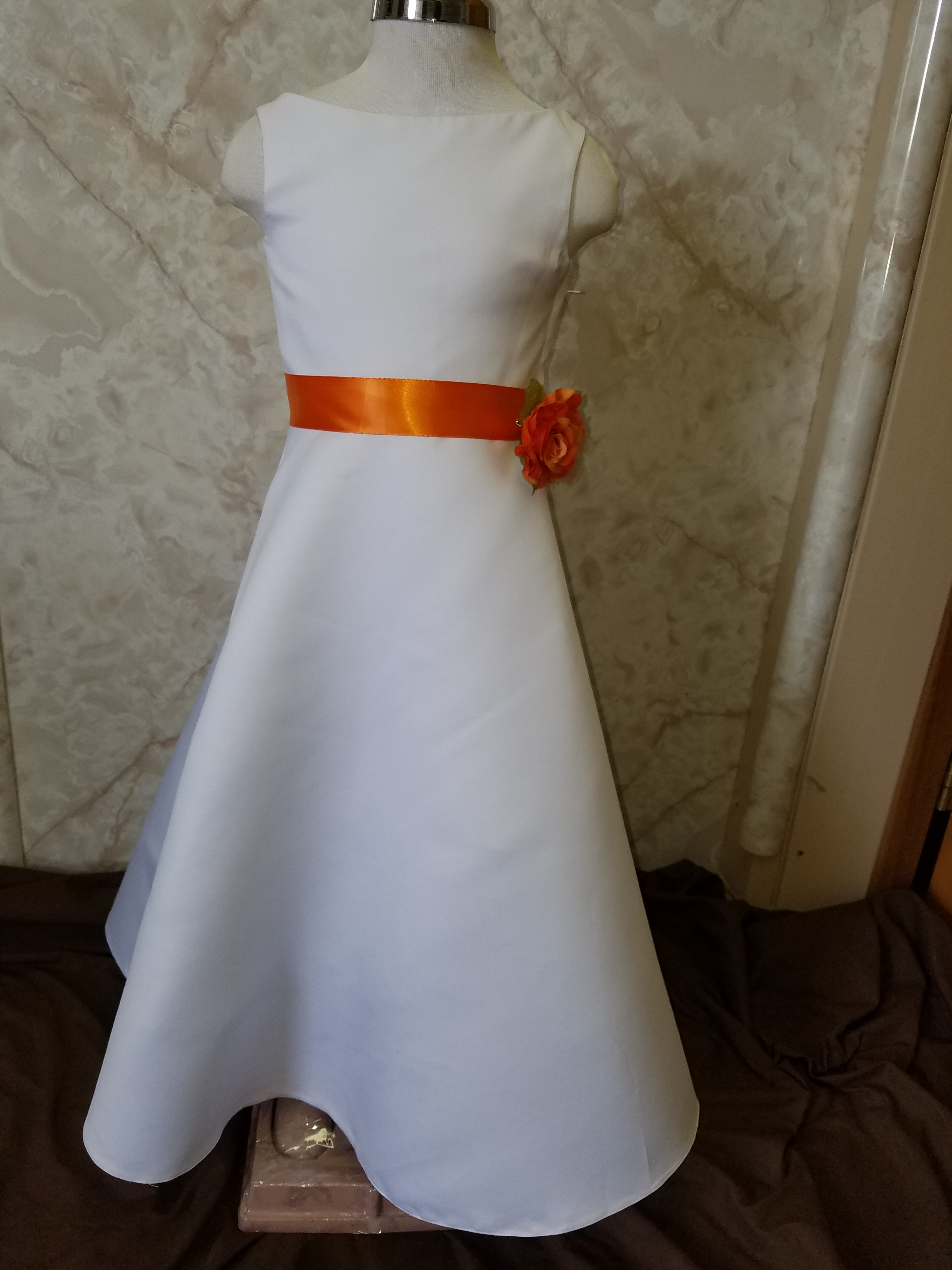 long white flower girl dress with orange sash