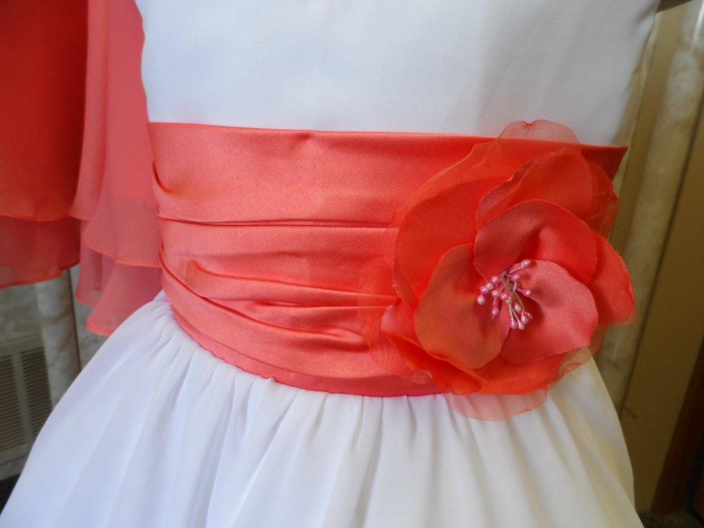 coral and white pleated sash