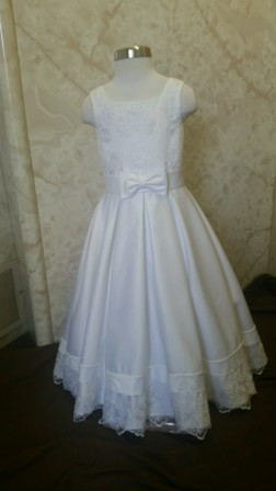 White satin and lace miniature bride dress with bow waist. On sale for $50