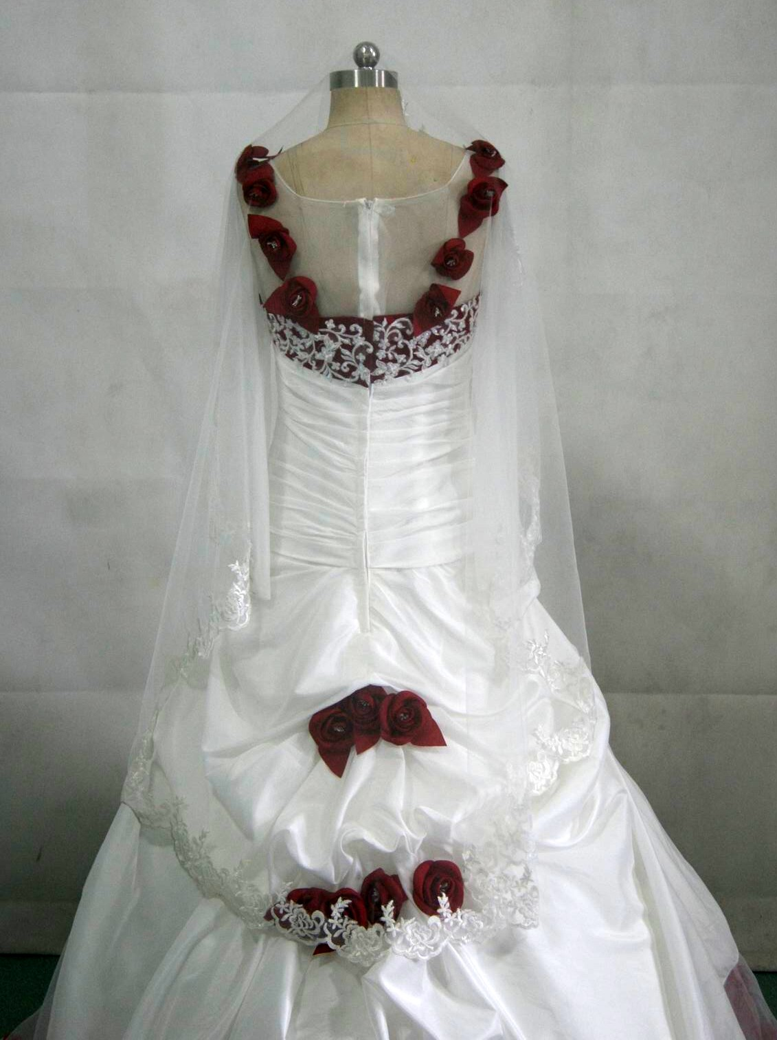 White wedding gown with red roses.