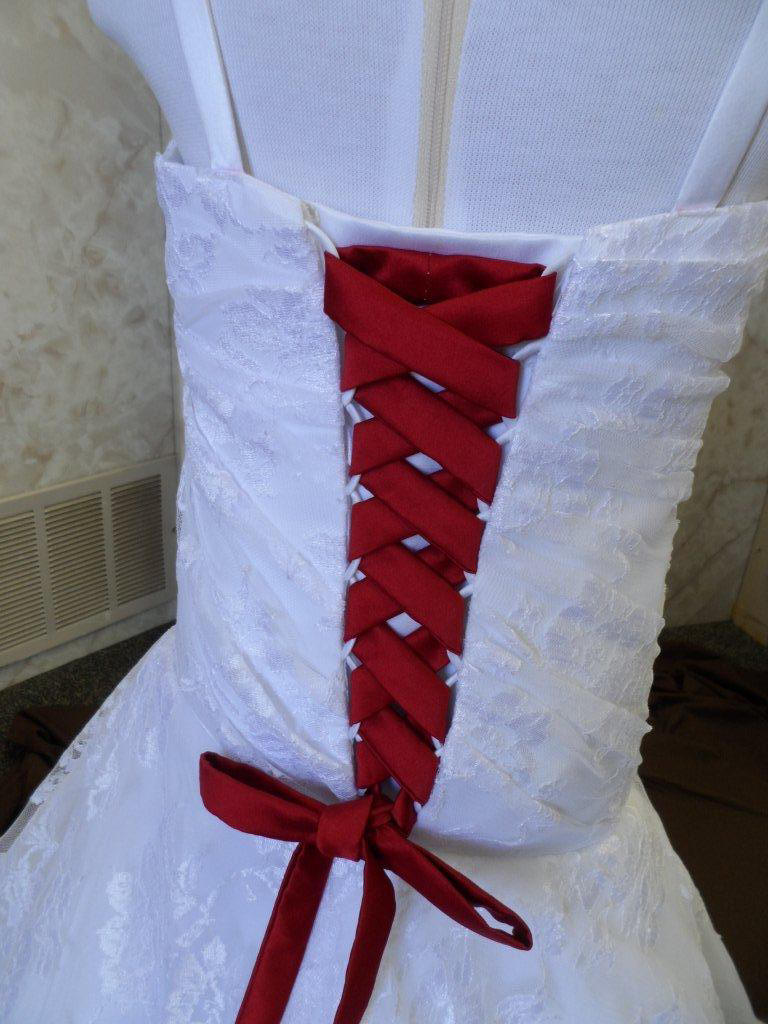 White lace wedding gown | red corset lace up.