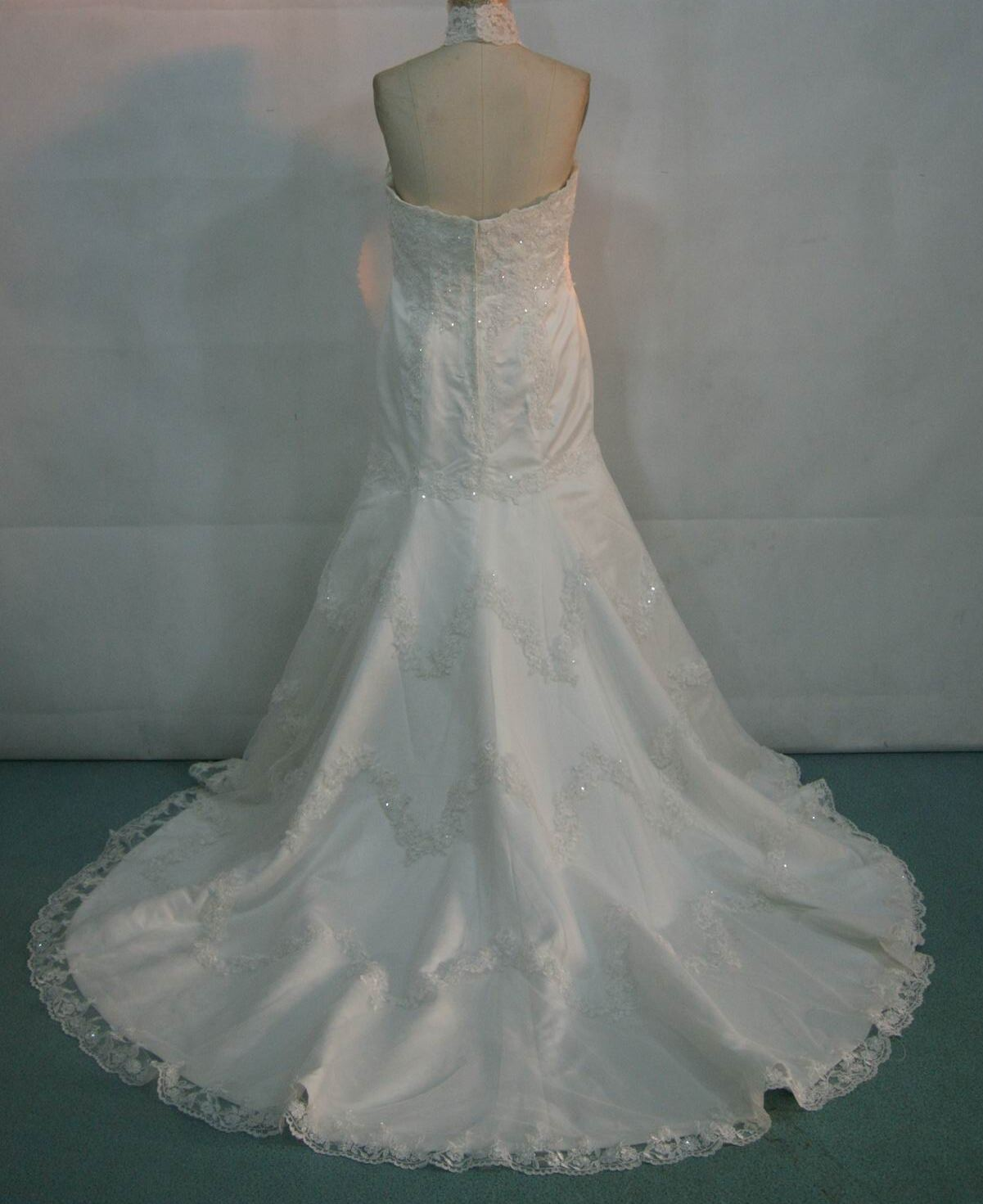 Halter mermaid bridal gown with lace overlay