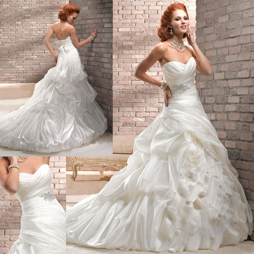 7ff090f19e95 Ruffle Wedding Dress · Fitted A-line gown featuring billowing bustles ...