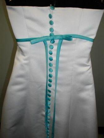 White dress with pool blue trim