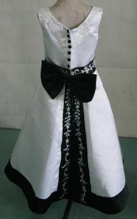 8c1c6029ea9 ... White sleeveless dress with black trim and rich embroidery