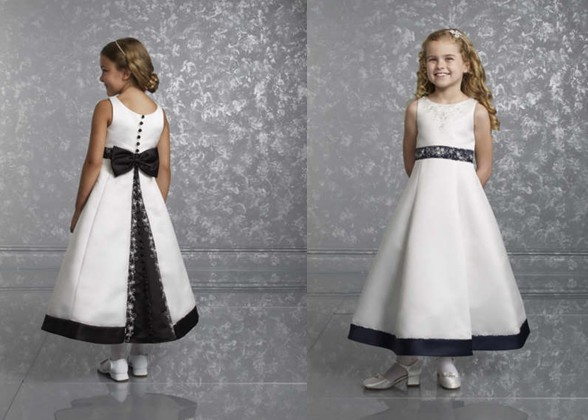 4749cc554 black wedding party dresses · White Sleeveless Flower Girl Dress. Black  contrasting covered buttons, bow and trim ...