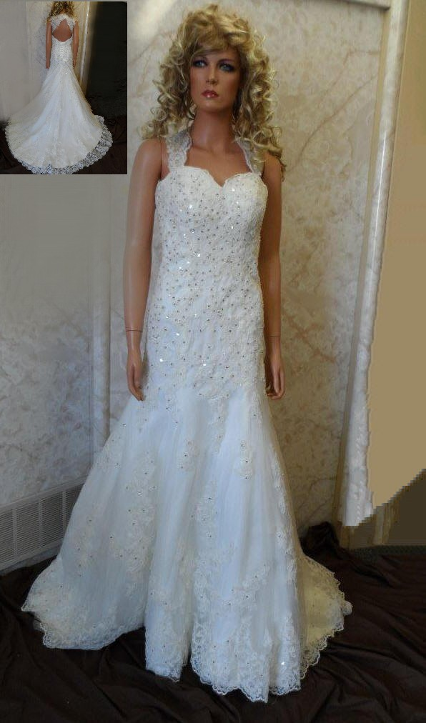 Lace wedding dress with open back and beaded wedding sash.