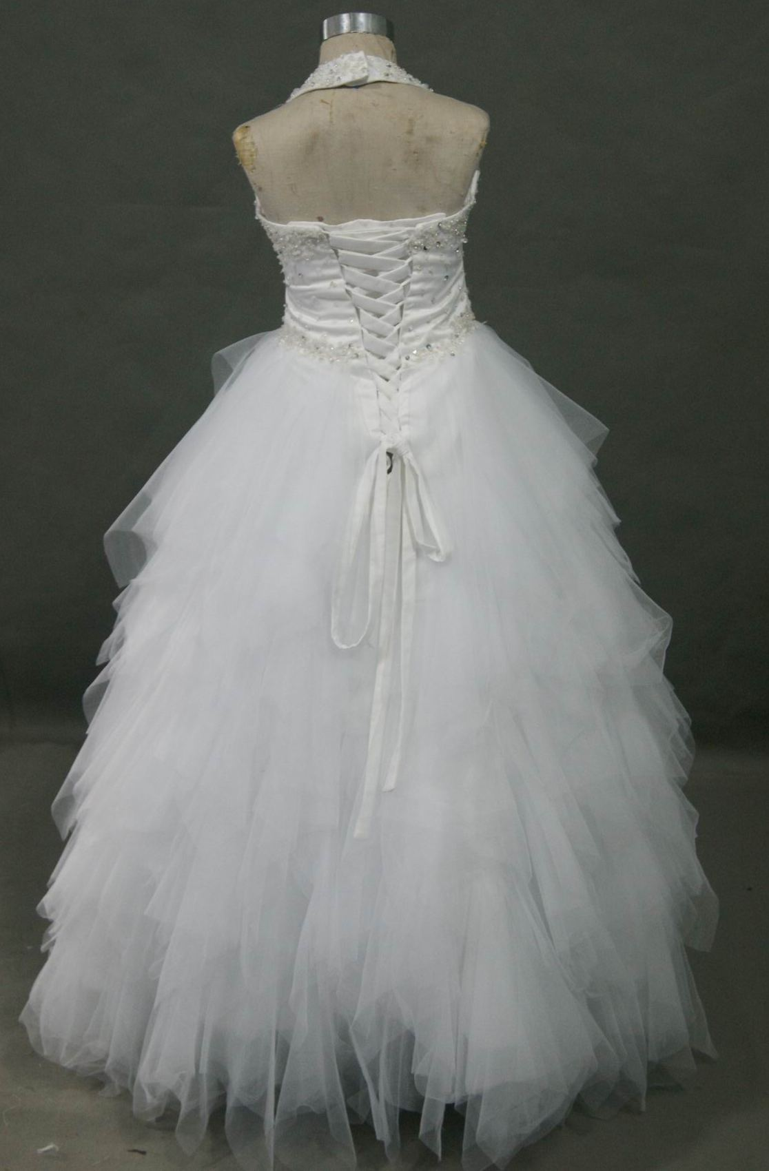 Pageant dress white and full layered handkerchief hem.