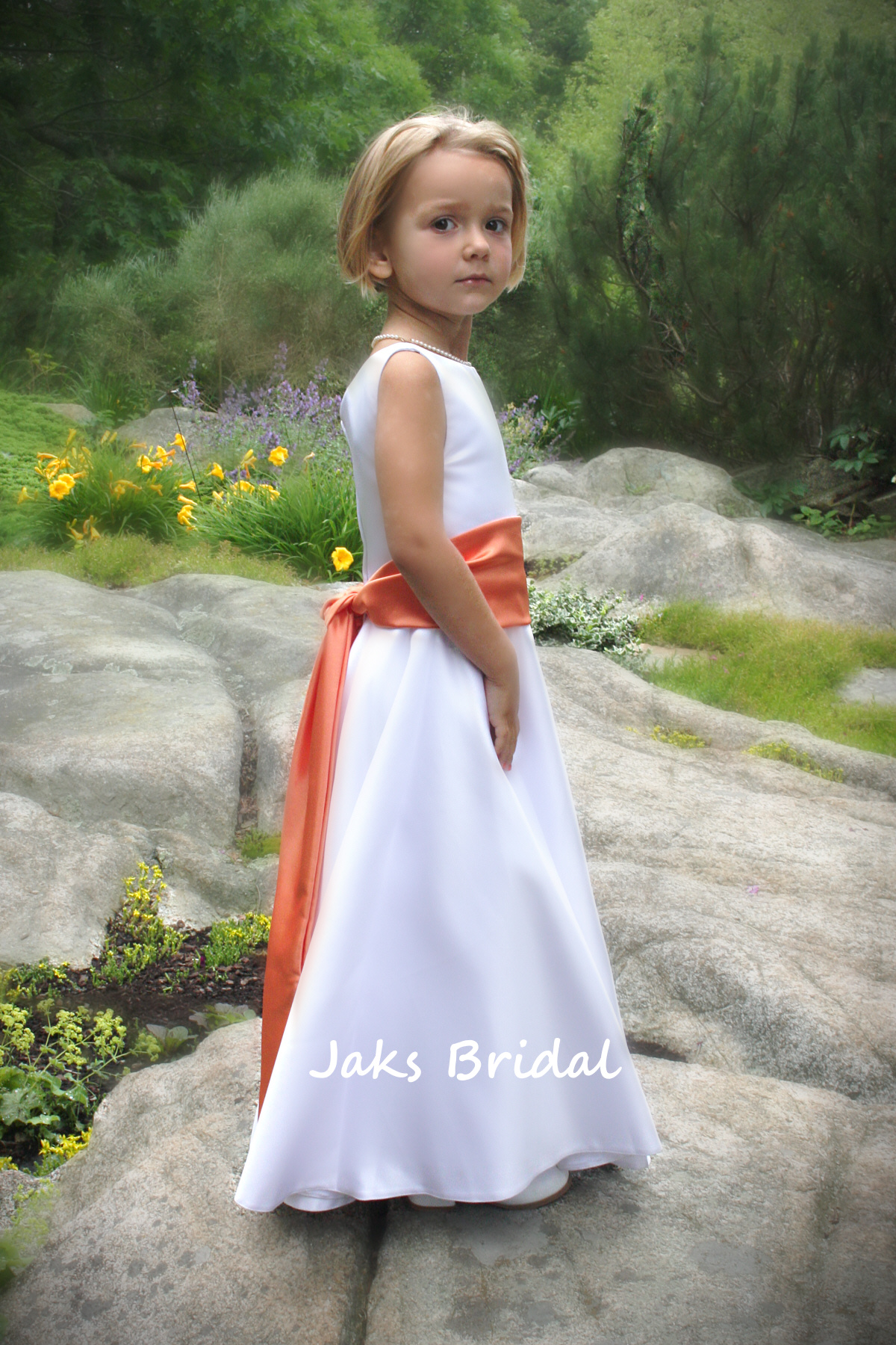 White munion dress with colorful sash