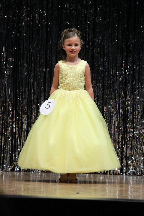 yellow sleeveless pageant dress