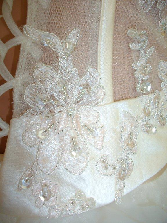Organza sheer corset top wedding dress Sheer corset bodice is accented with