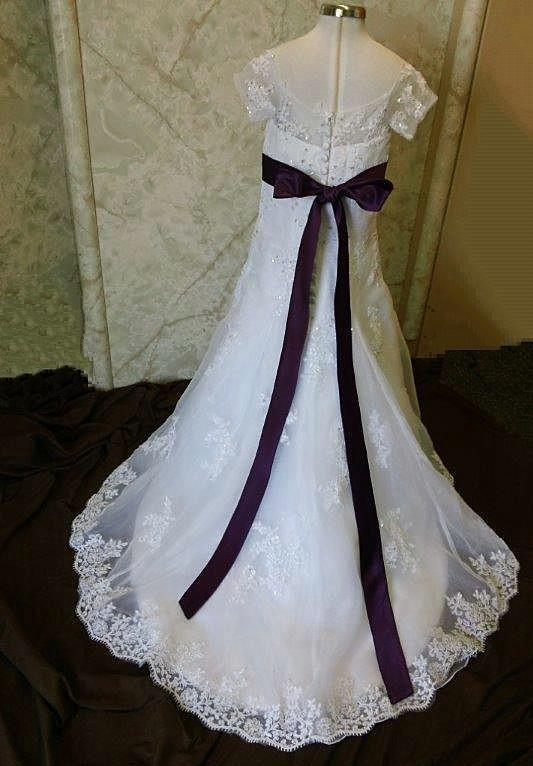 White and purple flower girl dresses.
