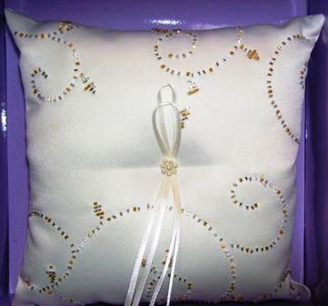Beaded pillow with gold accents