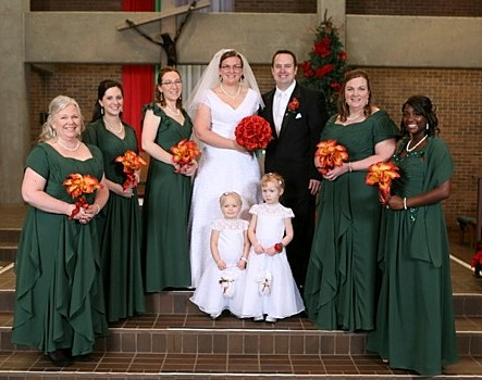 Christmas Wedding Bridesmaids In Matching Color Gowns