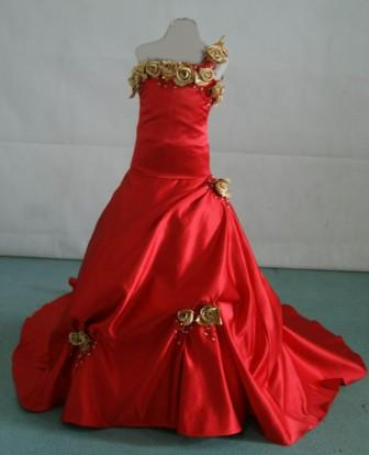 red one shoulder gown with gold rose strap