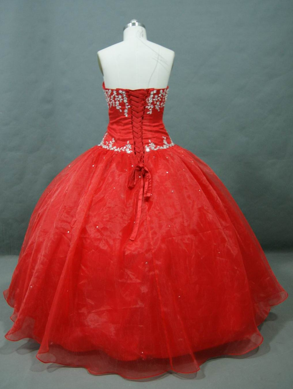 Red prom dress with beaded applique