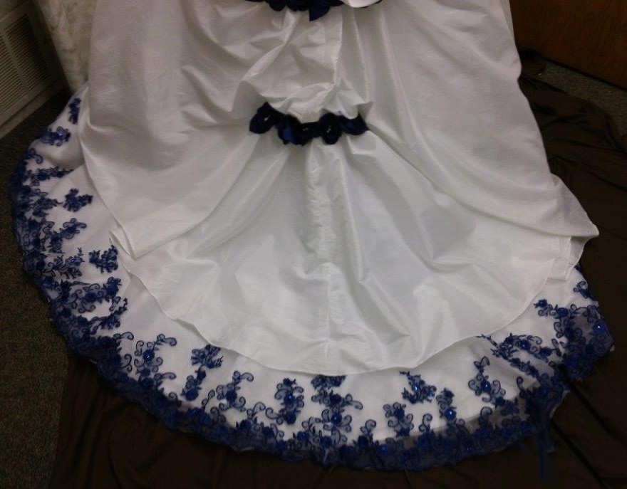 White Wedding Gown With Royal Blue Roses