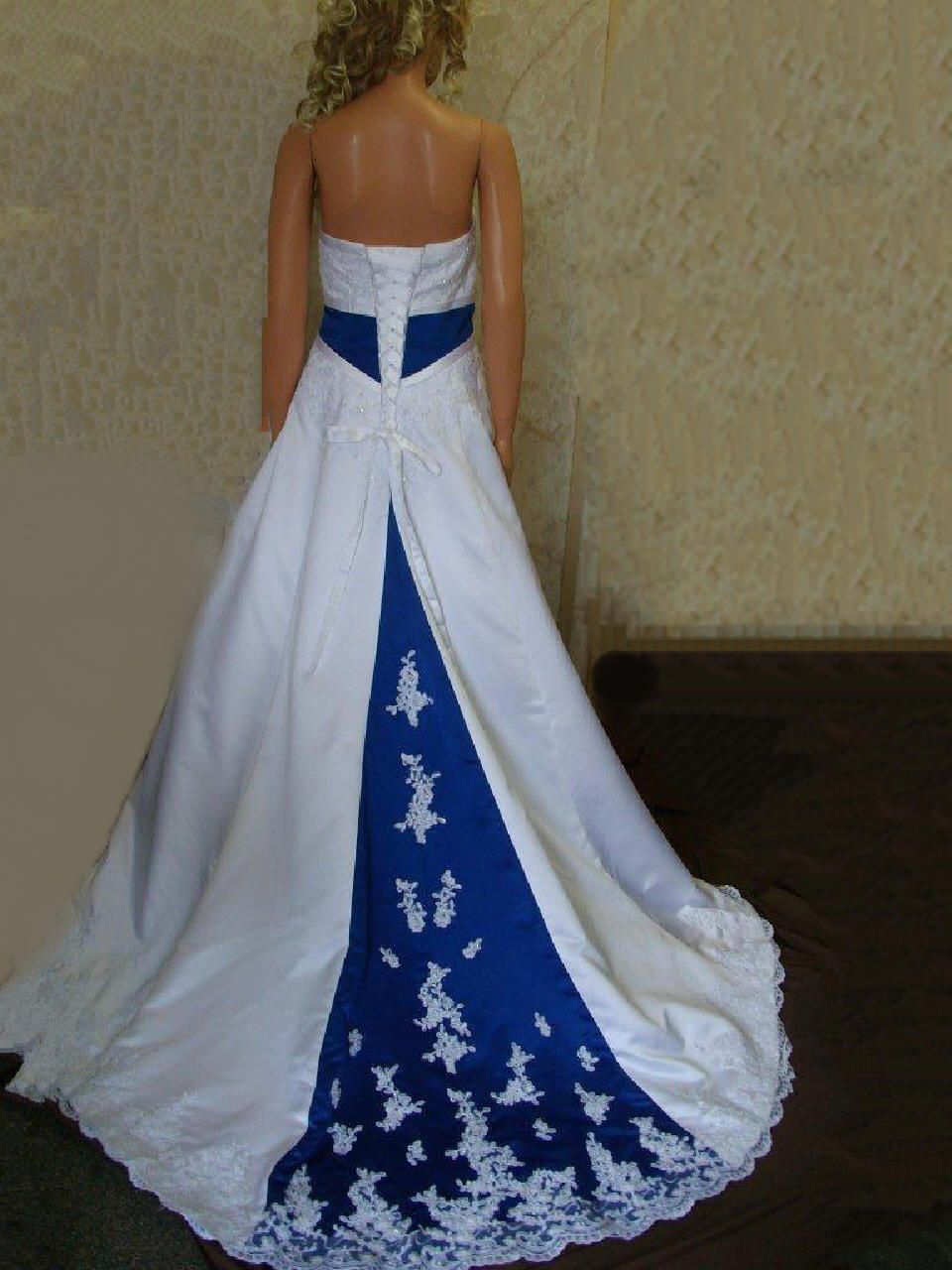 Royal blue empire banded wedding gown for Blue and black wedding dresses