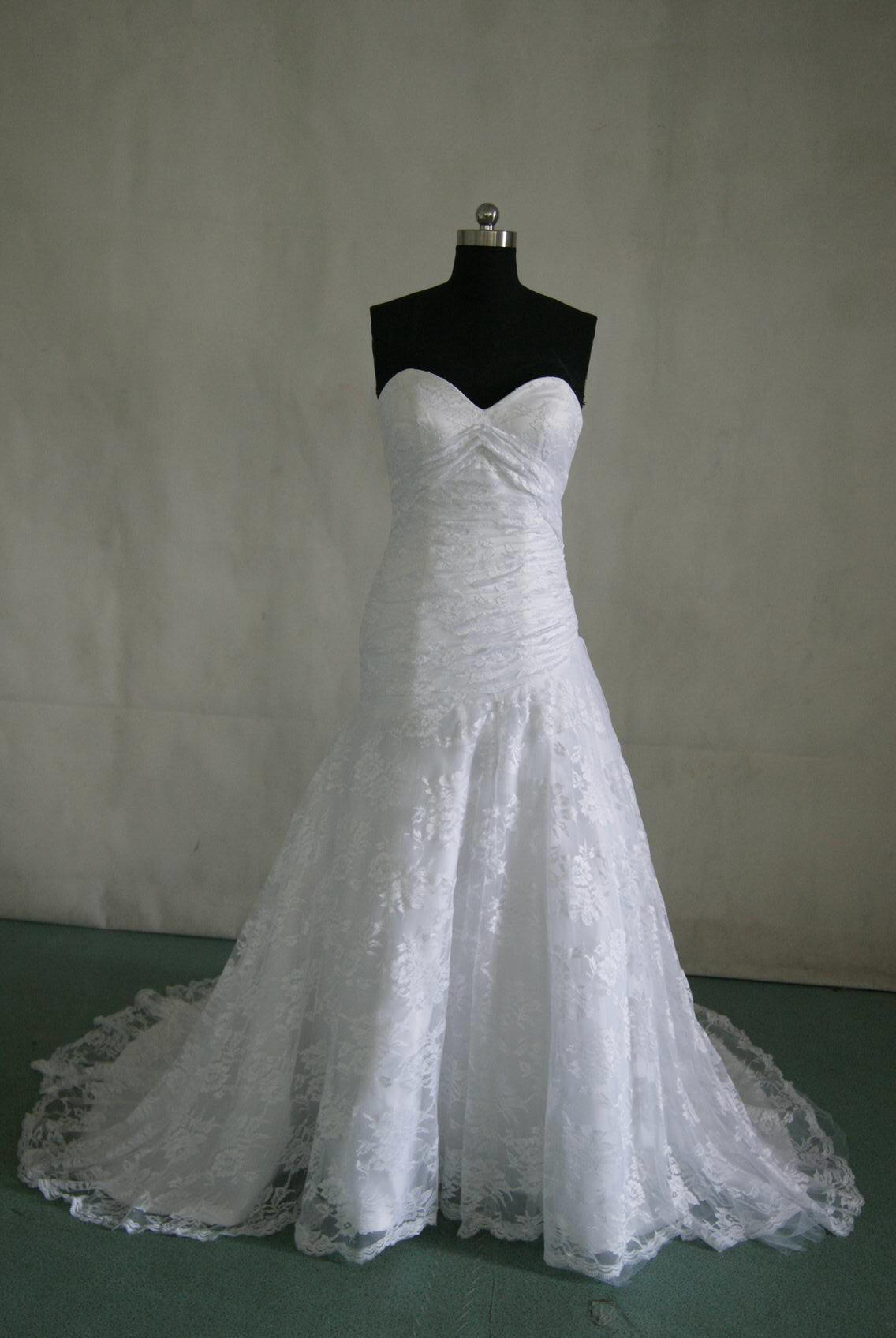 White lace wedding gown with strapless sweetheart neckline